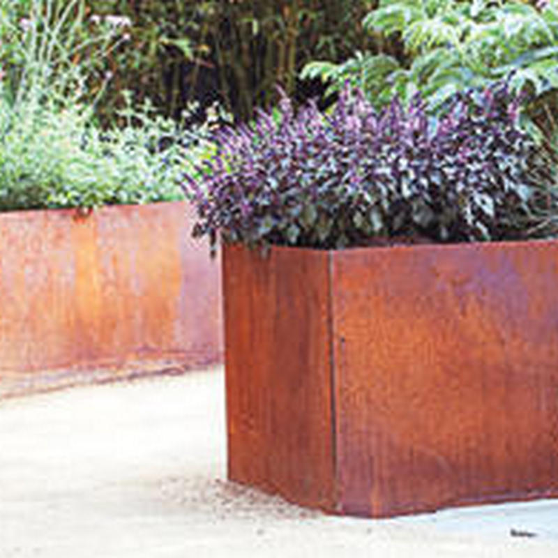 corten garden planter acting as a retaining wall